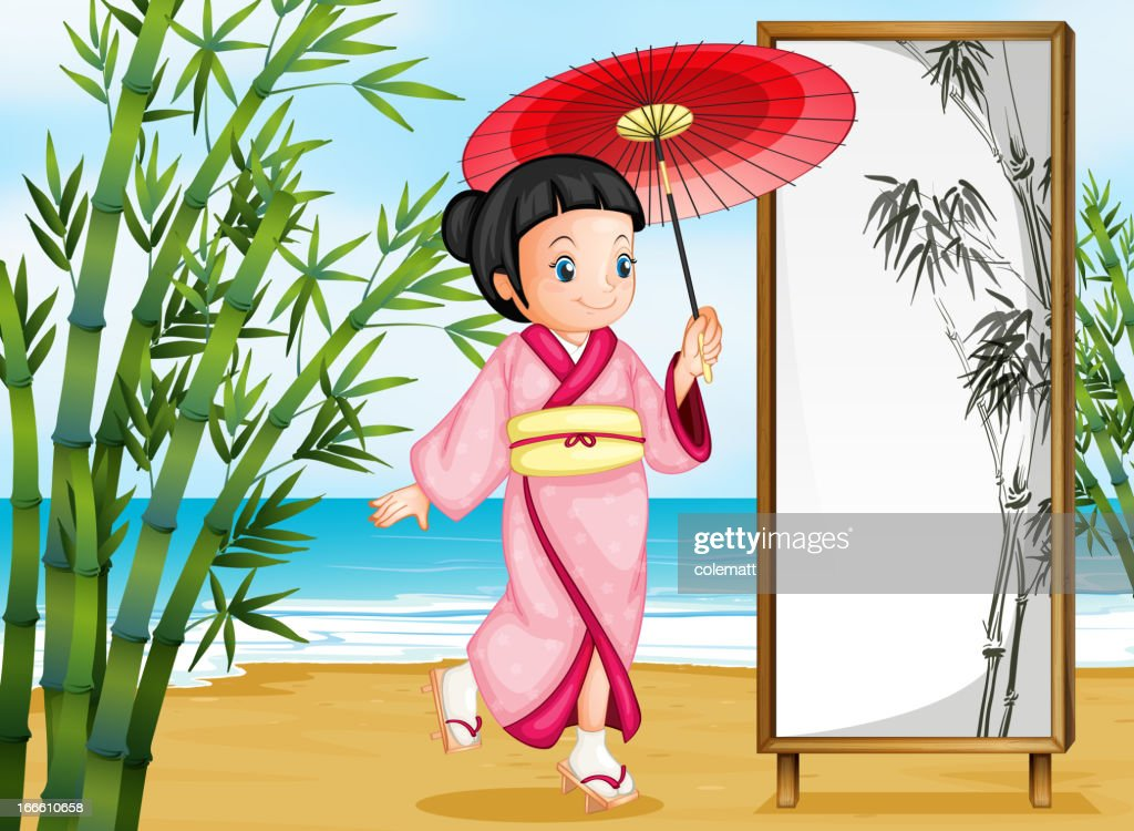 Lady wearing a pink kimono with an umbrella