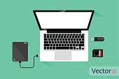 Laptop and Hard disk storage, Vector design on green background.