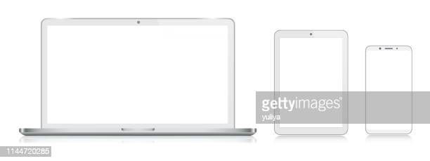 laptop, tablet, smartphone, mobile phone in silver color with reflection, realistic vector illustration - portability stock illustrations