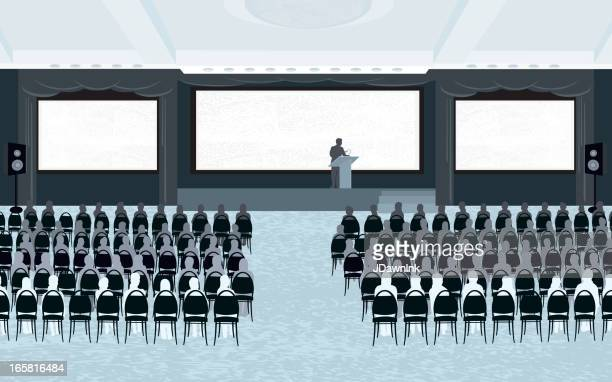 Large conference room with speaker and three screens