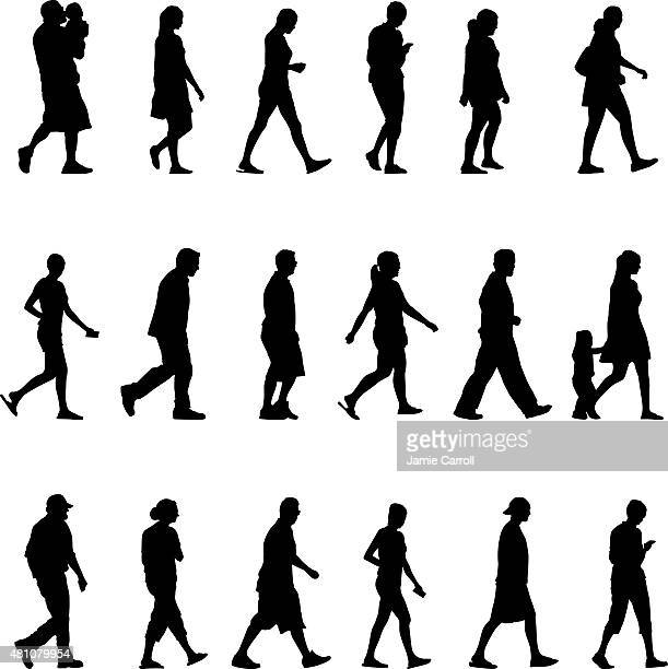 Large group of silhouette people walking