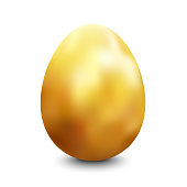 Large oval gold painted chicken egg standing vertically on a white surface lit up from the top casting a shadow