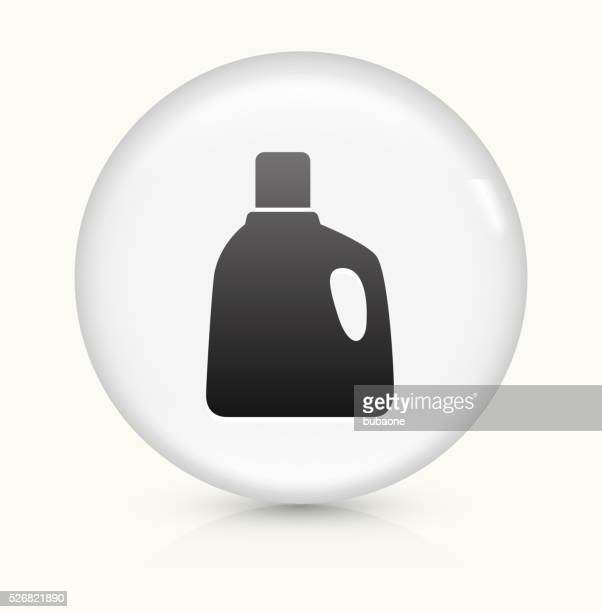 laundry detergent icon on white round vector button - laundry detergent stock illustrations, clip art, cartoons, & icons