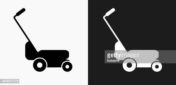 黒と白のベクトルの背景上の芝刈機アイコン