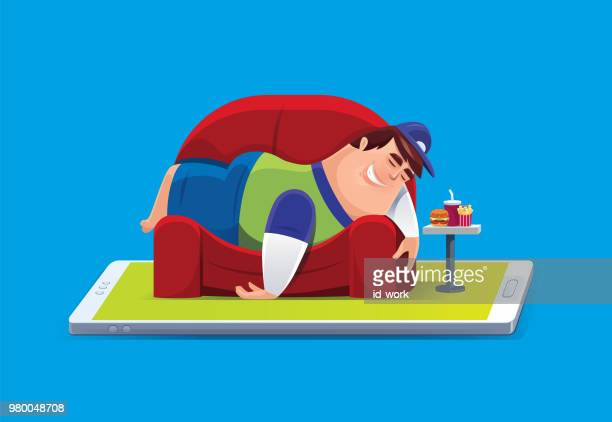 lazy fat man lying on sofa with smartphone