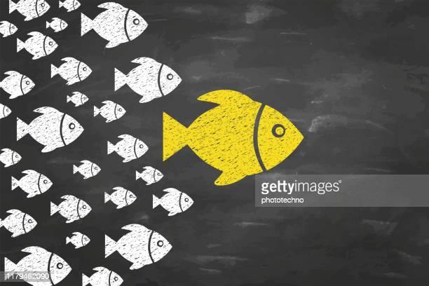 ilustraciones, imágenes clip art, dibujos animados e iconos de stock de conceptos de liderazgo con peces en el fondo de blackboad - persuasión