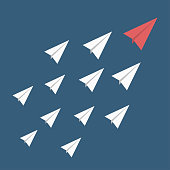 Leadership, stand out of the crowd concept. Red paper airplane as a leader among others white