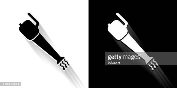 leaf blower black and white icon with long shadow - leaf blower stock illustrations