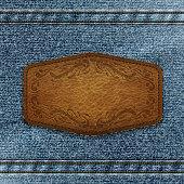 Leather label on denim