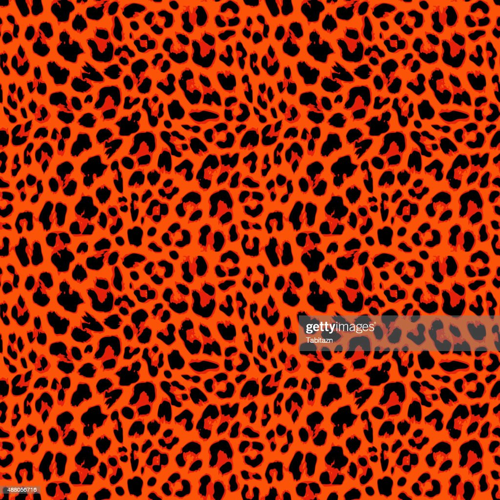 Leopard seamless pattern design in orange autumnal color, vector