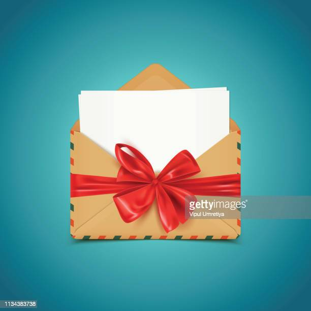 letter in an envelope decorated with shiny satin gift bow - envelope stock illustrations