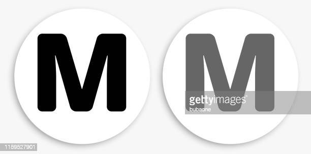 letter m black and white round icon - letter m stock illustrations, clip art, cartoons, & icons