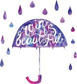 Lettering on umbrella Rain is beautiful