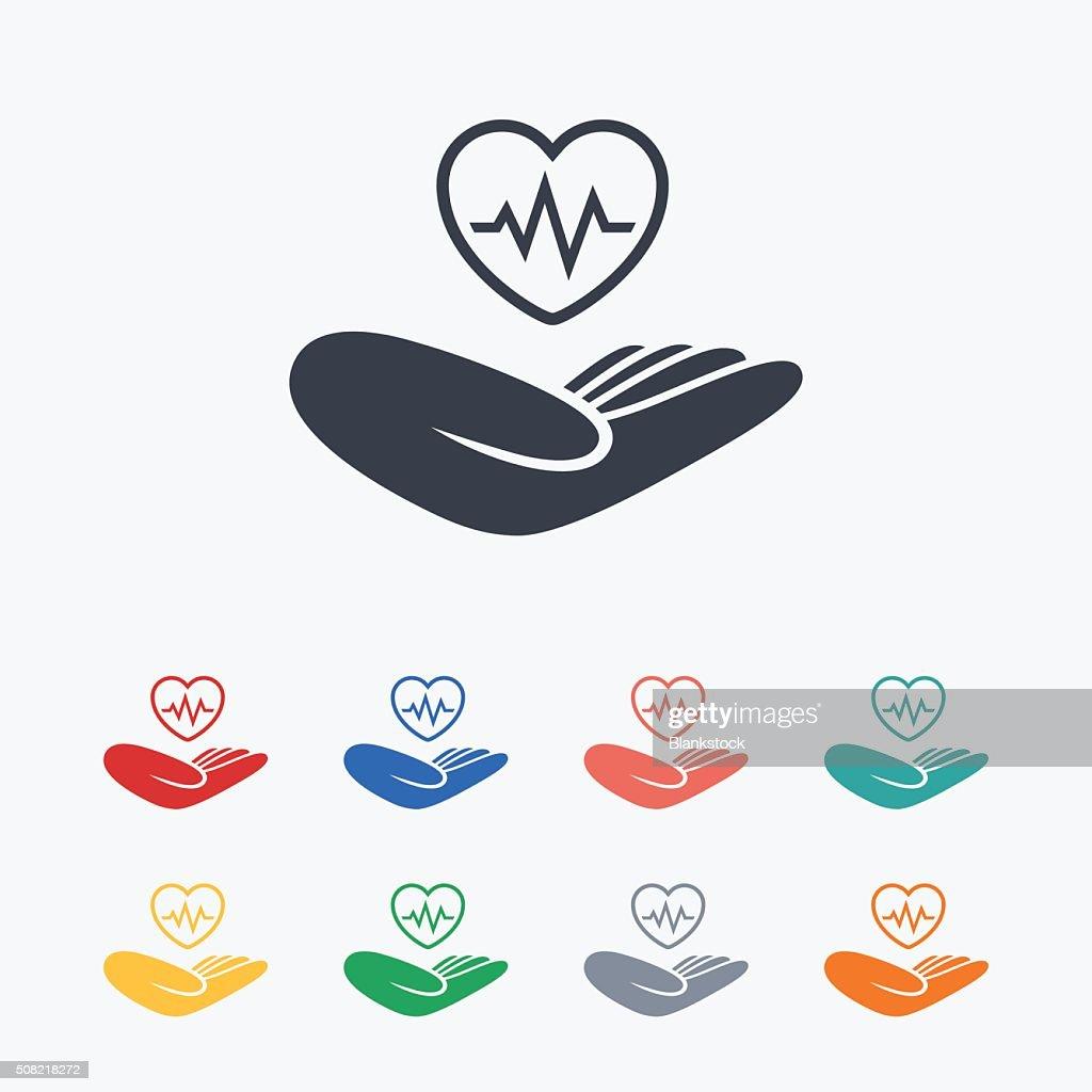 Life insurance sign. Hand holds heart.