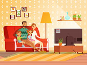Lifestyle of modern family. Mother, father and children watching tv