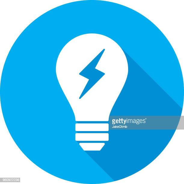 light bulb lightning bolt icon silhouette - light bulb stock illustrations