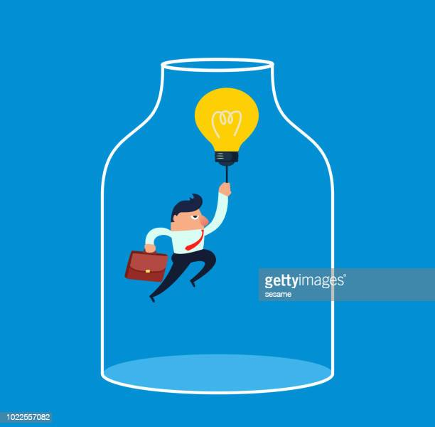 Light bulb takes the businessman out of the glass bottle