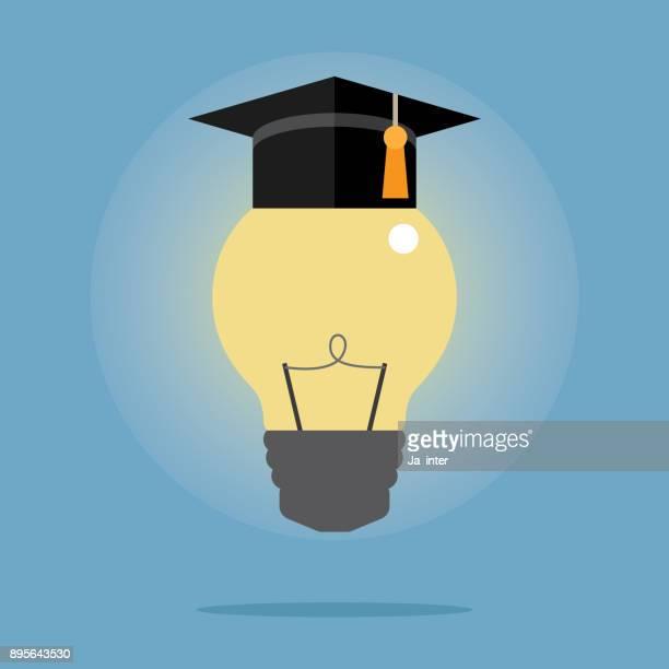 glühbirne mit doktorhut - hochschulstudium stock-grafiken, -clipart, -cartoons und -symbole