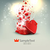 Light composition with a red box, a lot of hearts and glitter,