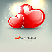 Light composition with two elegant red hearts and a lot of glitter,