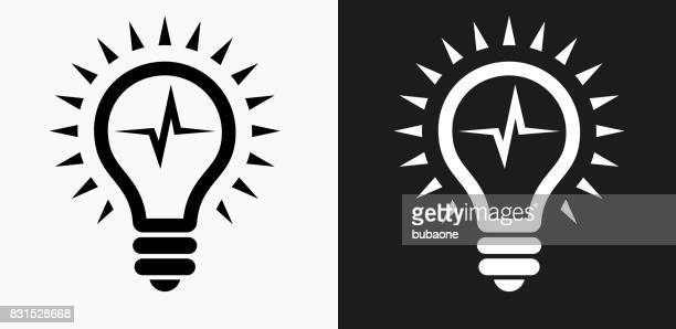 lightbulb icon on black and white vector backgrounds - light bulb stock illustrations