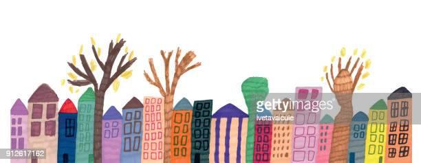 Linie der Häuser und Bäume