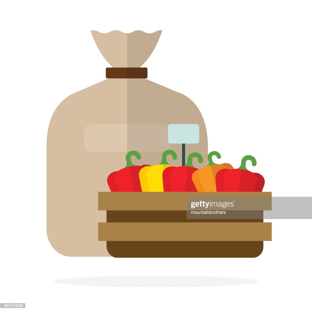 Linen sack and sweet peppers in a wooden container flat isolated
