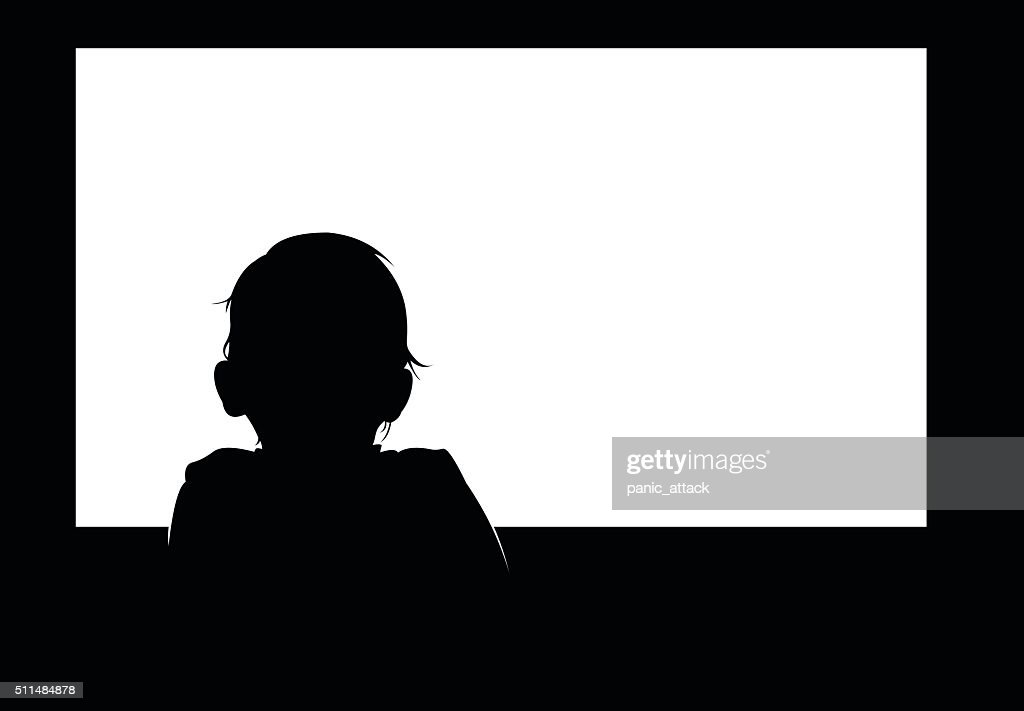 Little baby boy watching blank white television screen.