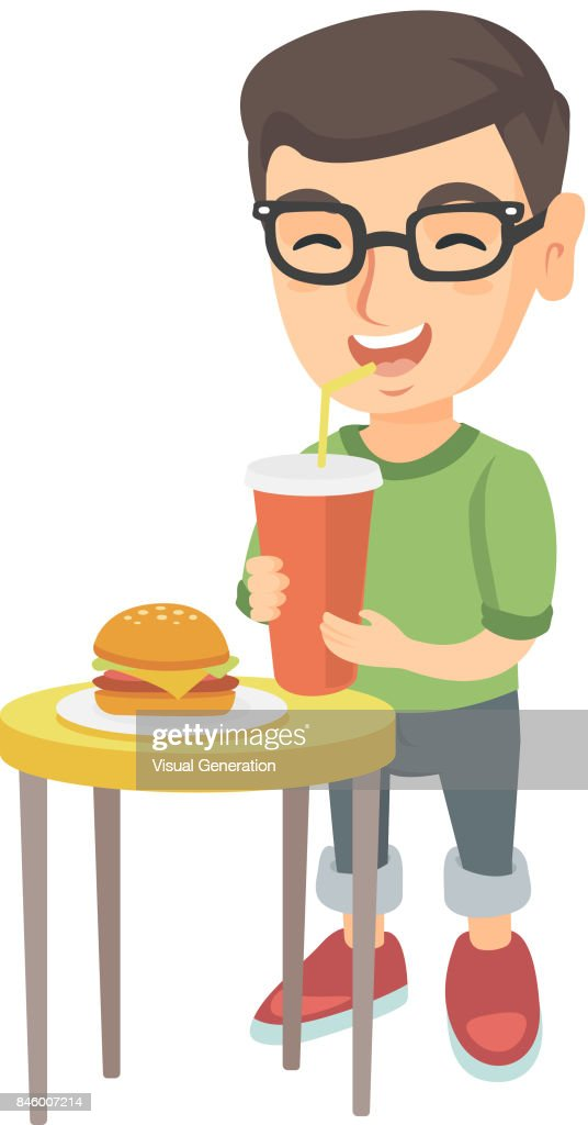 Little boy drinking soda and eating cheeseburger