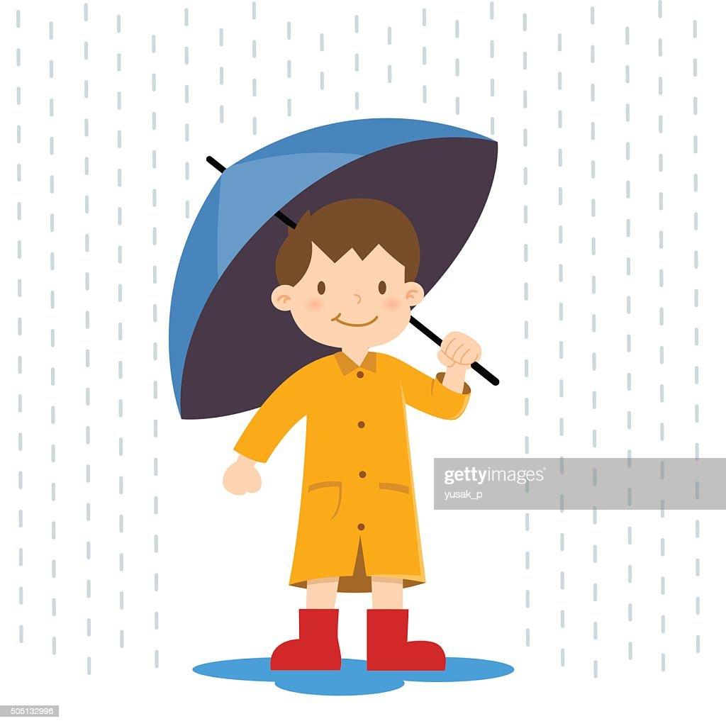 Little Boy Holding Umbrella in The Rain
