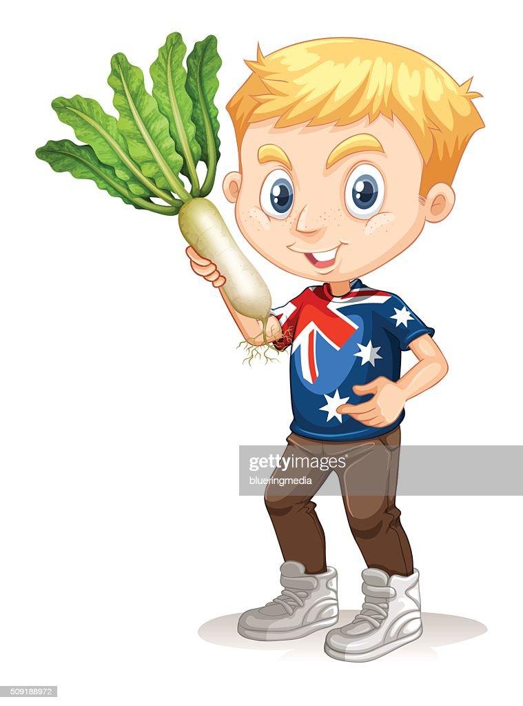 Little boy holding white radish