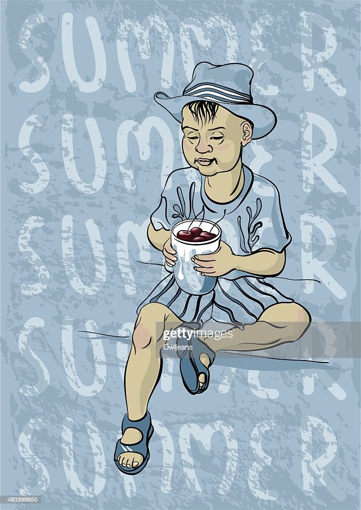 Little boy in a hat sitting with a mug of cherries