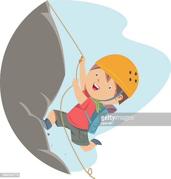 Little Boy Rock Climbing