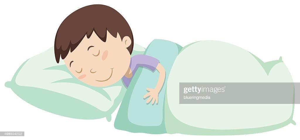 Little boy sleeping under blanket