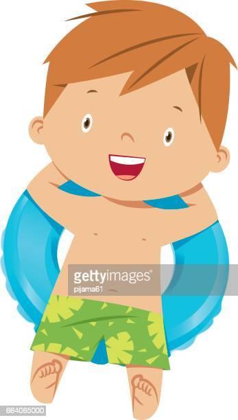 Little boy swims in pool