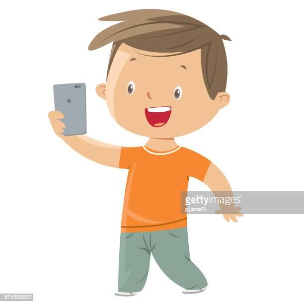 Little boy taking a selfie