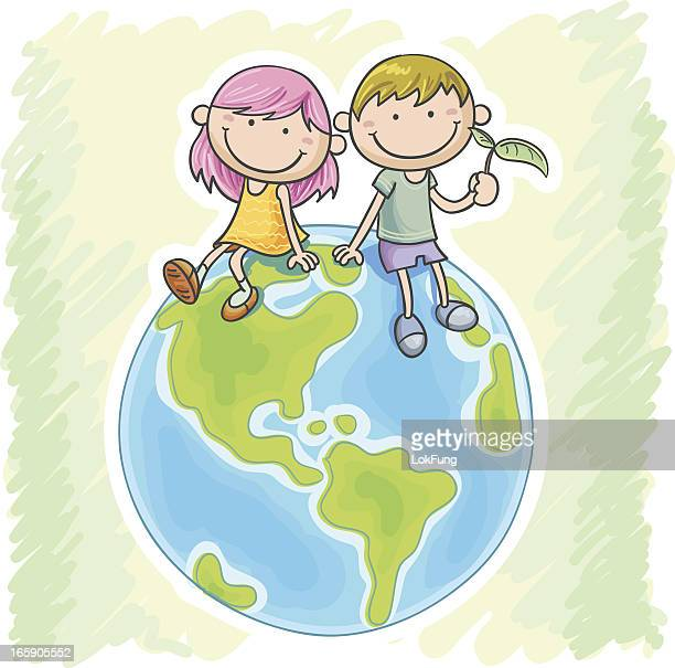 Little girl and boy sitting on the globe