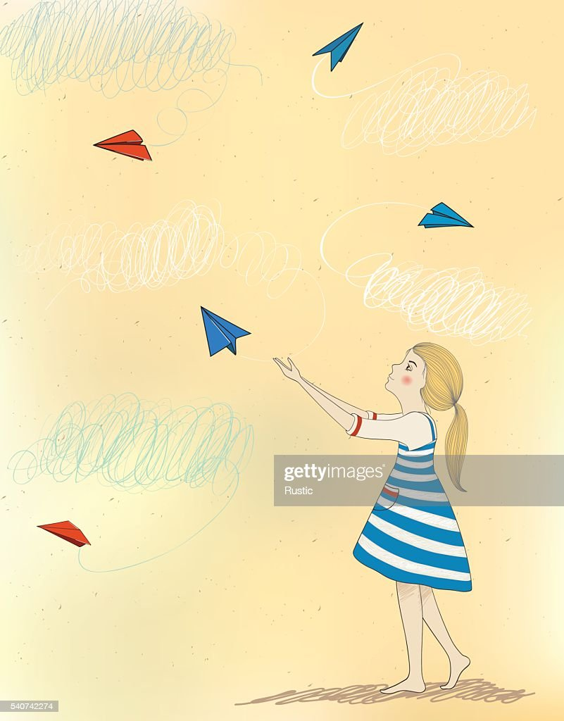 Little girl and paper airplanes.