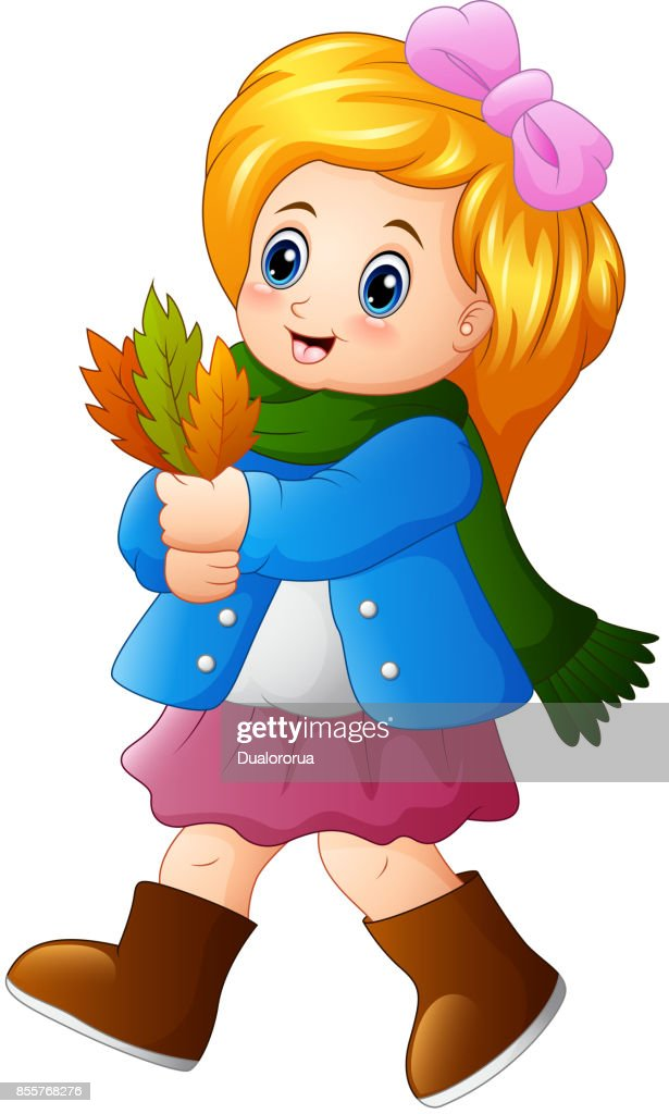 Little girl holding autumn leaves