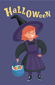Little girl in witch costume. Basket on Halloween