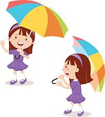 Little girl with multicolor umbrella
