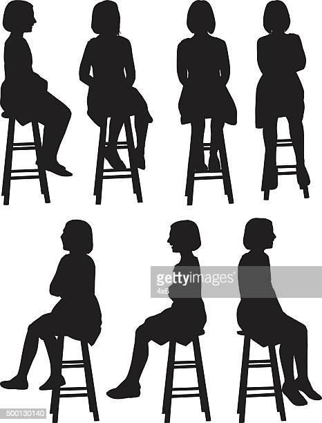 little girls sitting on stool - stool stock illustrations, clip art, cartoons, & icons
