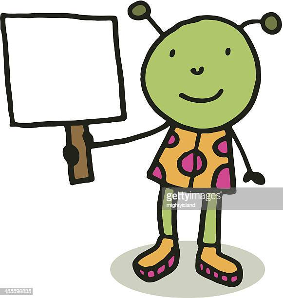 Little green man alien holding a blank sign