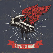 Live to ride.  Motorcycle helmet with wings on grunge background