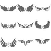 Logo of black wings with a star.