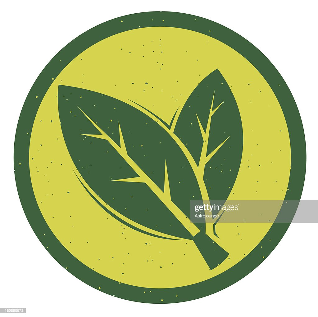 A logo of two green leaves in a yellow background