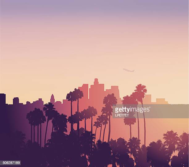 los angeles sunset scene with palm trees - skyline stock illustrations