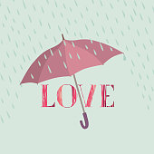 Love lettering over rain under umbrella protection. Valentine's greeting card