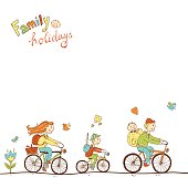 Lovely friendly family with two children traveling by bike, a