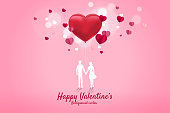 Lover couple holding hand with heart shape balloon.